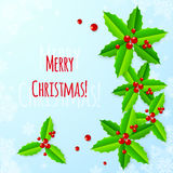 Paper Christmas greeting card with holly Stock Photography