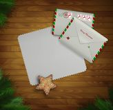 Paper Christmas invitation and two mail envelopes on the wooden background with christmas tree,. Vector Royalty Free Stock Images