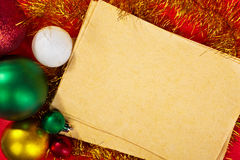 Paper and Christmas Ornaments Royalty Free Stock Image