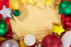 Paper and Christmas Ornaments Stock Photo