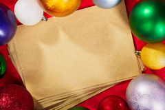 Paper and Christmas Ornaments Royalty Free Stock Photos