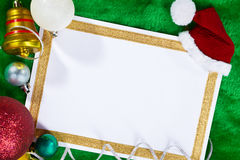 Paper and Christmas Ornaments Stock Photography