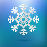 Paper christmas snowflake on a blue. + EPS8. White paper christmas snowflake on a blue background. + EPS8 vector file Royalty Free Illustration