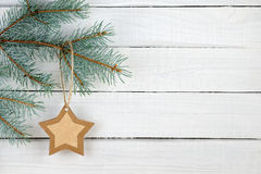Paper Christmas star and branches of blue spruce Stock Photography