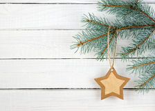 Paper Christmas star on spruce branch Stock Photos