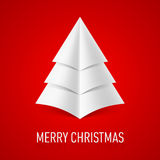 Paper Christmas tree. Abstract paper Christmas tree on red background. Greeting card Royalty Free Stock Image