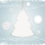 Paper Christmas tree background on blue Stock Image