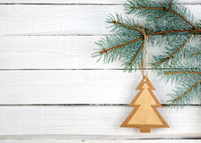 Paper Christmas tree on spruce branch Royalty Free Stock Image