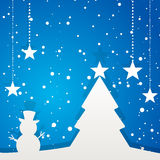 Paper Christmas tree and winter scene. Paper Christmas Tree and Snowman on a Blue Background with White stars Stock Photos