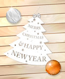 Paper christmas tree with wish on wooden background Royalty Free Stock Image