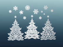 Paper Christmas trees and snowflakes Stock Photo