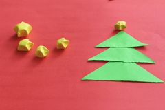 Paper Christmas trees and stars. Royalty Free Stock Photo