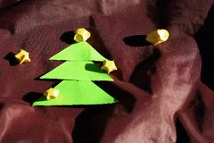 Paper Christmas trees and stars. Stock Images