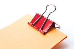 Paper clamp. Red paper clamp on a white background Stock Illustration