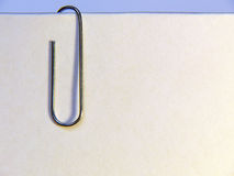 Paper with clip. Blank paper with clip on it. Close up Stock Photography