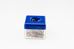 Paper clip box with on top a magnet to hold some paper clips Royalty Free Stock Photo