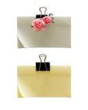 Paper-clip che tiene le note in bianco Fotografia Stock