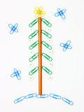 Paper clip Christmas tree. Christmas fur-tree from paper clips for a paper on a white background Stock Image