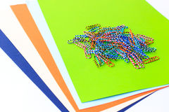 Paper Clip on color paper Royalty Free Stock Images
