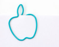 Paper clip in the form of apple Stock Images