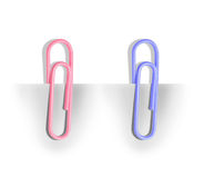 Paper clip holding a blank paper sheet Stock Photo