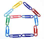Paper clip house. Brightly colored paper clips in the shape of a house stock photography