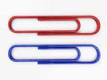 Paper clip isolated. 3d rendering. Paper red and blue clips isolated image with soft shadows. 3d rendering Royalty Free Stock Photography