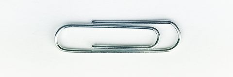 Paper Clip. Metal Paper clip to hold papers together Stock Images