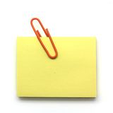 Paper clip and notepad  on white Stock Images