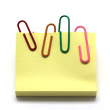 Paper clip and notepad  on white Royalty Free Stock Image