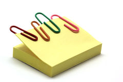 Paper clip and notepad  on white Royalty Free Stock Photos