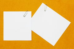 Paper clip and paper Stock Images