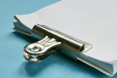 Paper clip and paper. Clip and note paper stock photo