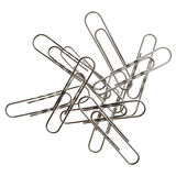 Paper Clip Pile. Small pile of paper clips. Silver design on white background Royalty Free Stock Photography