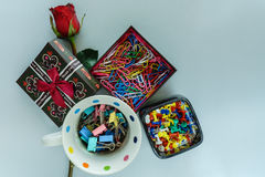 Paper clip, pin and rose. View from above Stock Image