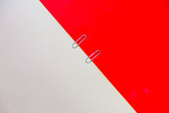 Paper clip with red and cream background. Hipster and School Concept Royalty Free Stock Photos