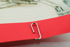 Paper clip and red paper Royalty Free Stock Images