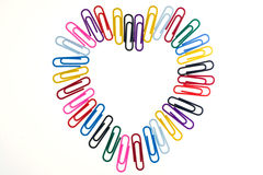 Paper clip in the shape of a heart . Stock Images