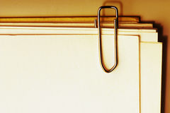 Paper clip with stack of blank paper Stock Image