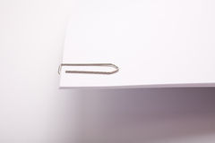 Paper clip on white paper Royalty Free Stock Photography