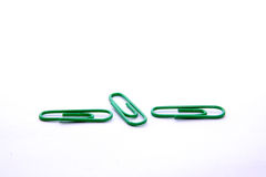 Paper clips. Three green paper clips o the white background Stock Image