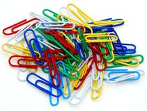 Paper clips. Brightly colored paperclips in a pile royalty free stock photo
