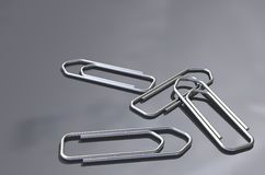 Paper clips. On a bacgground Stock Photos