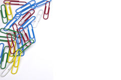 Paper clips. Several paper clips as a frame on a white background Stock Photos