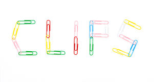 Paper clips. White background stationery Royalty Free Stock Image