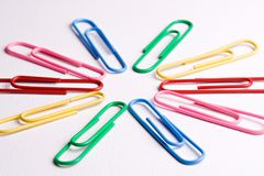 Paper clips. Colorful paper clips on a white background royalty free stock photo