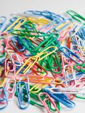 Paper clips. Colorful paper clips on a white background royalty free stock images