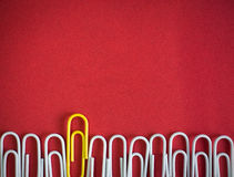 Paper clips arrange to symbolize to be different or leadership Royalty Free Stock Images