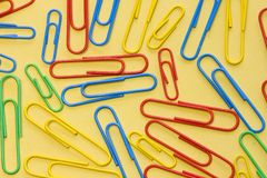 Paper clips background. Paper clips on a yellow background Royalty Free Stock Photography