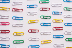 Paper clips background. Colored paper clips on a white background Stock Photo